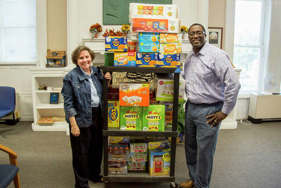 Counselor Renee Bauer and Architectural Technology/Drafting and Design Program Coordinator Joel Hall deliver a large donation to the Trailblazer Snack Pantry from the Lewis and Clark Community College Faculty Association. Photo: Photo By Louise Jett, L&C Media Specialist