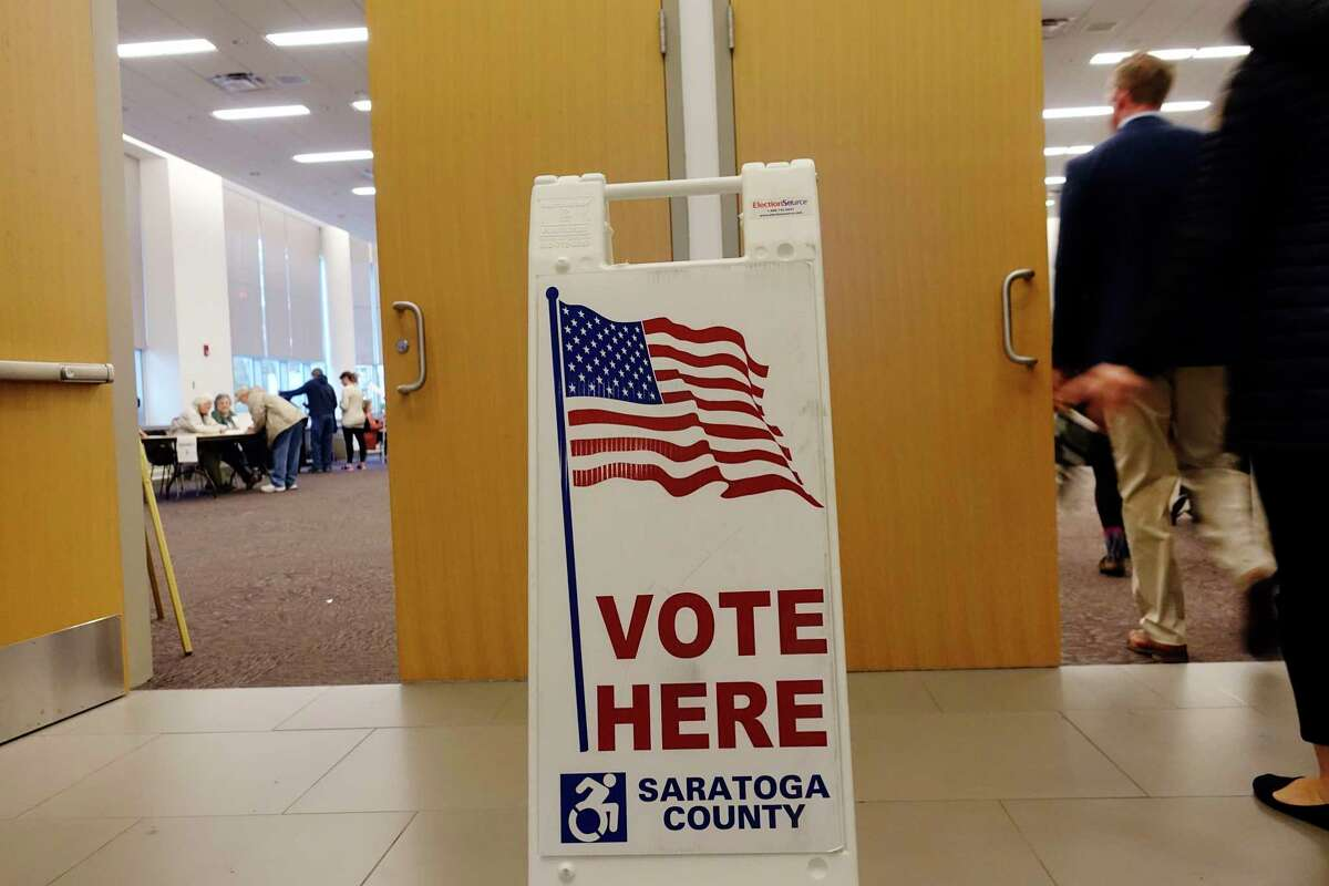 Voters stream in to cast their ballots at the Saratoga City Center on Tuesday, Nov. 6, 2018, in Saratoga Springs, N.Y. Along with voting for candidates, voters in Saratoga Springs are voting on an amendment that if passed would change the city's charter. (Paul Buckowski/Times Union)