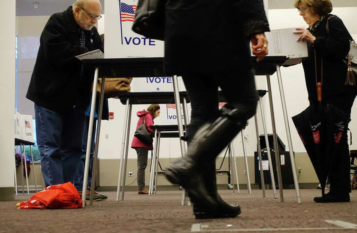 Voters fill out their ballots at the Saratoga City Center on Tuesday, Nov. 6, 2018, in Saratoga Springs, N.Y. Along with voting for candidates, voters in Saratoga Springs are voting on an amendment that if passed would change the city's charter. (Paul Buckowski/Times Union)