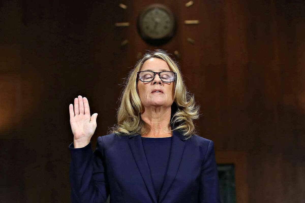 Christine Blasey Ford is sworn in before testifying the Senate Judiciary Committee in the Dirksen Senate Office Building on Capitol Hill on Thursday, Sept. 27, 2018 in Washington, D.C.