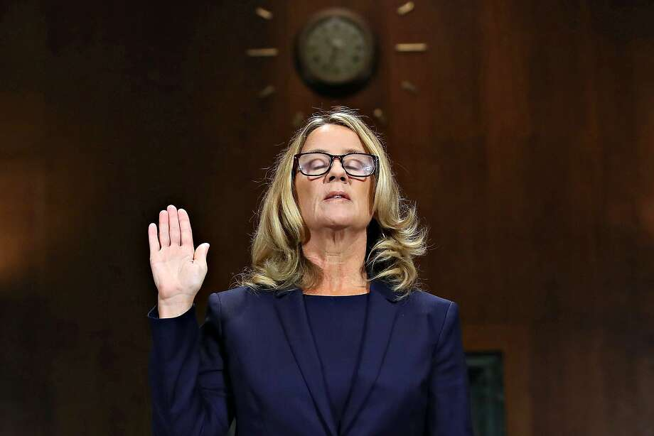 Christine Blasey Ford is sworn in before testifying the Senate Judiciary Committee in the Dirksen Senate Office Building on Capitol Hill on Thursday, Sept. 27, 2018 in Washington, D.C. Photo: Win McNamee, TNS