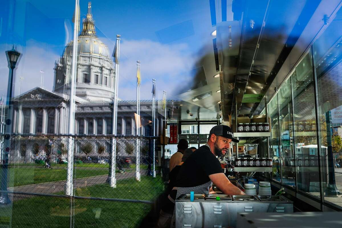 Jason Rose, a Bi-Rite cafe employee works at the cafe to get it ready a few days before it opens at Civic Center in San Francisco, California, on Sunday, Oct. 21, 2018.