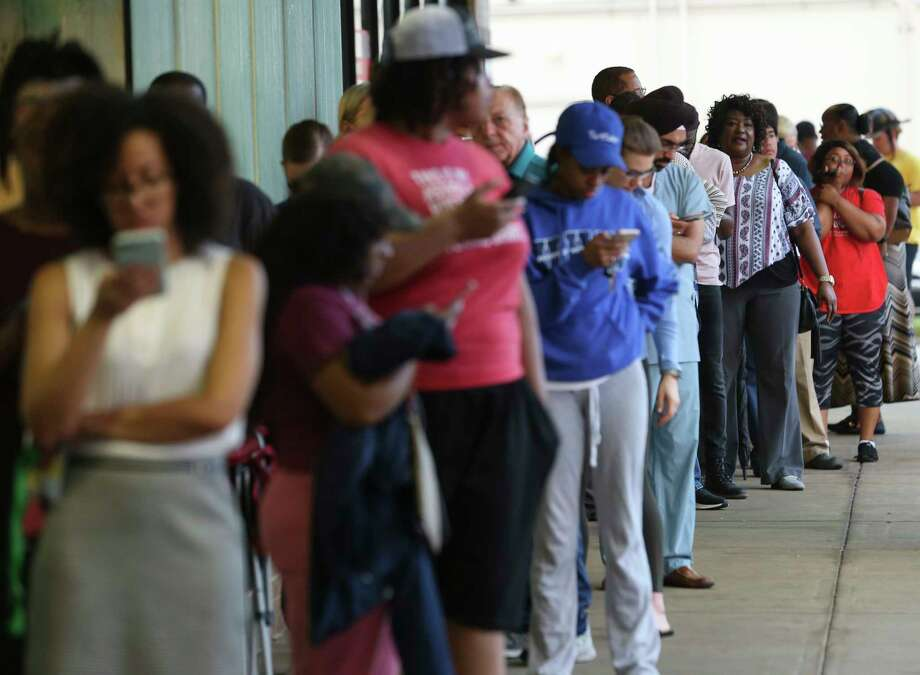 Voters wait in the line to vote at the Fiesta Mart on Kirby Drive and Old Spanish Trail on Election Day on Tuesday, Nov. 6, 2018, in Houston. Photo: Yi-Chin Lee, Staff Photographer / © 2018 Houston Chronicle