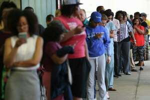 Voters wait in the line to vote at the Fiesta Mart on Kirby Drive and Old Spanish Trail on Election Day on Tuesday, Nov. 6, 2018, in Houston.