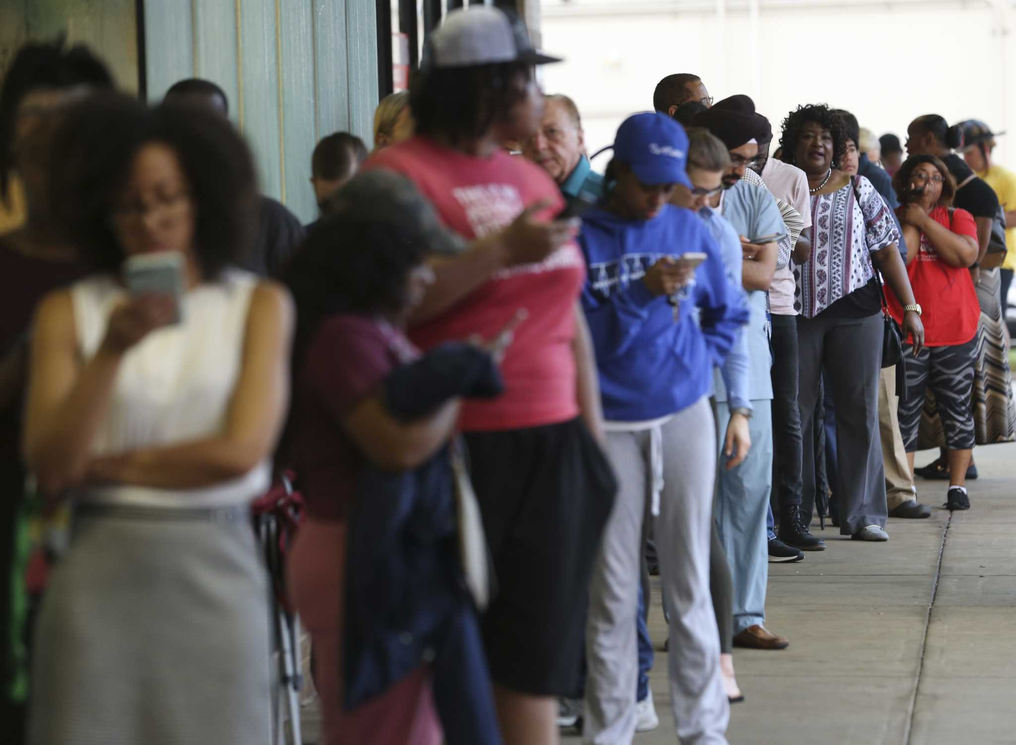 Long lines and machines down at multiple polling places across Houston