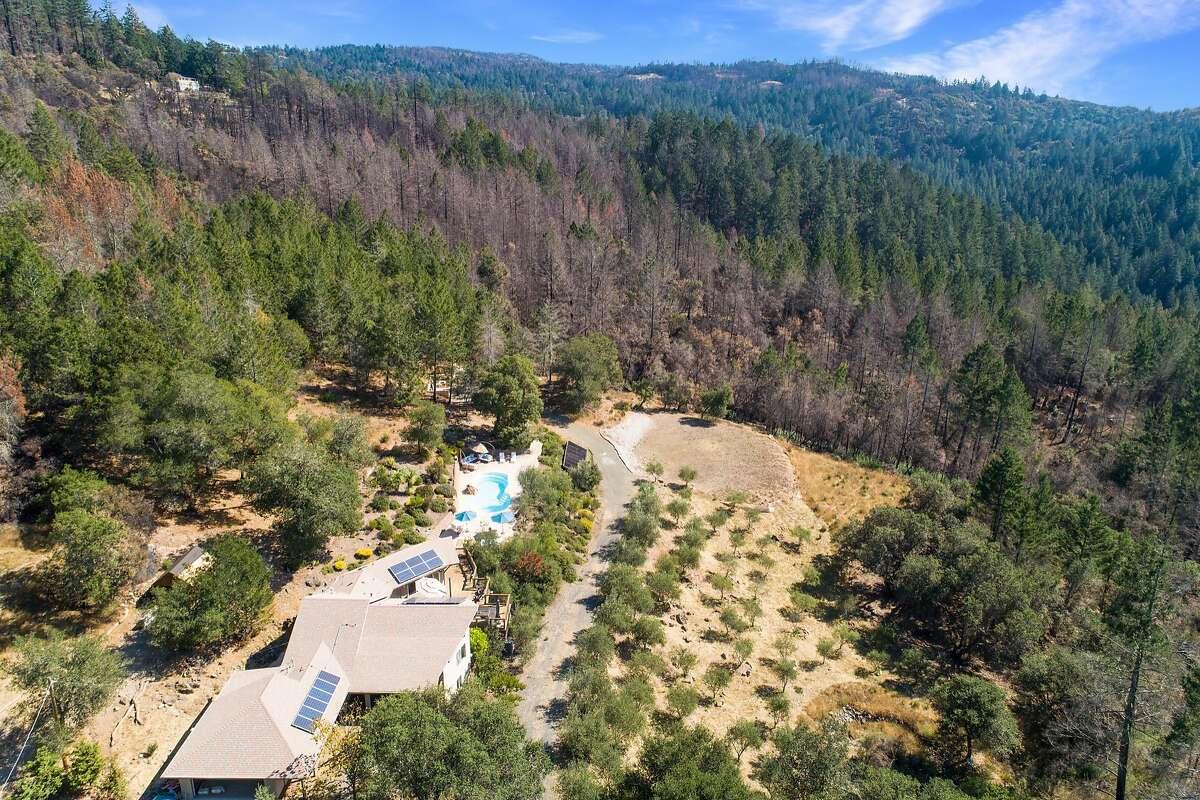 An aerial shot showcases the hillside setting in Glen Ellen.