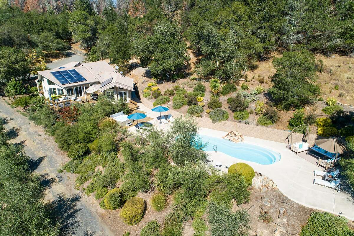The Glen Ellen home features solar panels and includes a massive concrete patio with a pool.