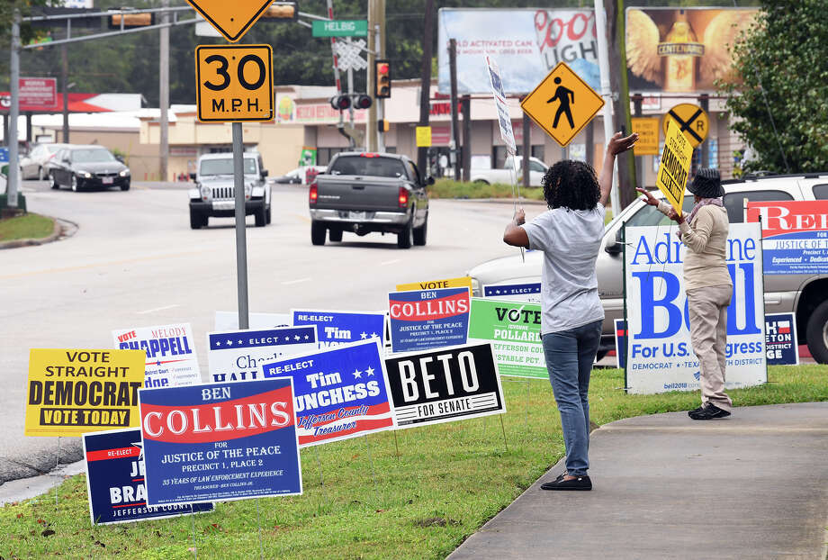 Maxine Black, left, and Patricia Bailey wave at drivers near Beaumont's John Paul Davis Community Center on Election Day.  Photo taken Tuesday, 11/6/18 Photo: Guiseppe Barranco/The Enterprise / Guiseppe Barranco ?