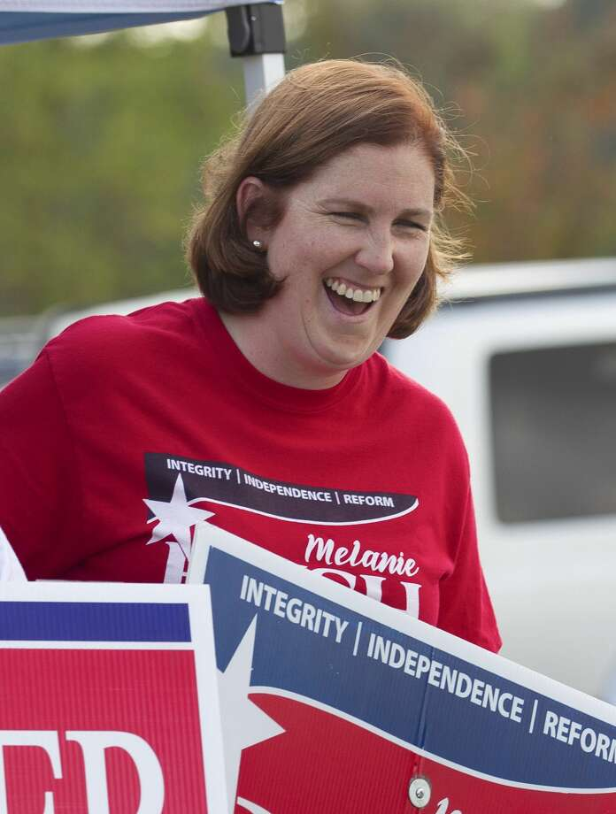 Melanie Bush, Republican candidate for Montgomery County treasurer, shares a laugh while campaigning in River Plantation on Election Day, Tuesday, Nov. 6, 2018, in Conroe. Photo: Jason Fochtman/Staff Photographer