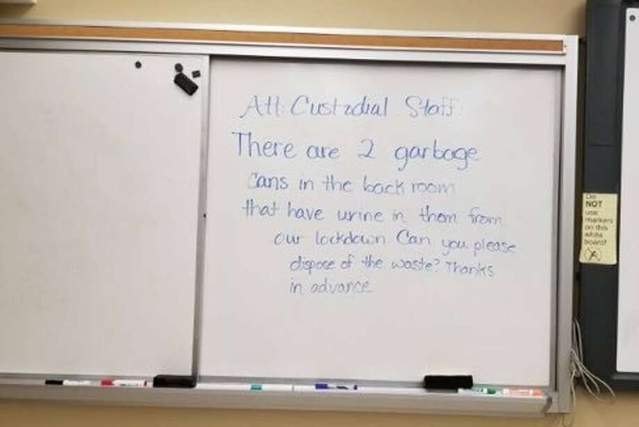 Niskayuna High School freshman Dante Marra took this picture of a whiteboard asking custodians to remove bags full of urine inside one of the last classrooms searched and cleared by police during a lockdown on Monday Nov. 5, 2018. (Provided by Dante Marra) Photo: Provided By Dante Marra