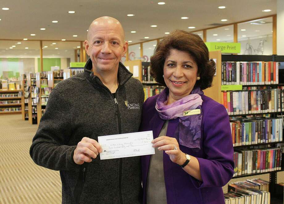 Mitch Ancona of Ancona's Wines & Liquors presents Wilton Library Executive Director Elaine Tai-Lauria with a check for $750 for Wilton Library's Bocce Brawlers 2nd place finish in the Branchville Civic Association's 4th annual bocce tournament. Photo: Contributed Photo / Contributed Photo / Norwalk Hour contributed