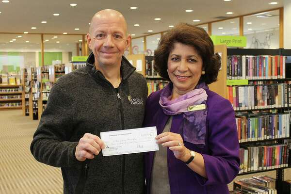 Mitch Ancona of Ancona?'s Wines & Liquors presents Wilton Library Executive Director Elaine Tai-Lauria with a check for $750 for Wilton Library?'s Bocce Brawlers 2nd place finish in the Branchville Civic Association?'s 4th annual bocce tournament.