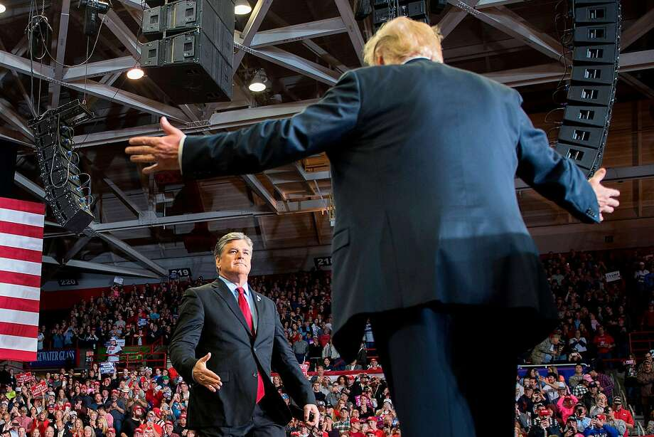 President Donald Trump greets talk show host Sean Hannity at a Make America Great Again rally in Cape Girardeau, Missouri on November 5, 2018. (Photo by Jim WATSON / AFP)JIM WATSON/AFP/Getty Images Photo: JIM WATSON, AFP/Getty Images