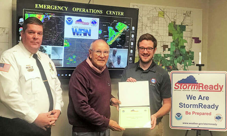 "NWS Warning Coordination Meteorologist Kevin Deitsch, right, presents Godfrey Mayor Mike McCormick and Village Public Safety Administrator Christopher Sichra with the National Weather Service's ""StormReady City"" recognition award. Photo: For The Telegraph"