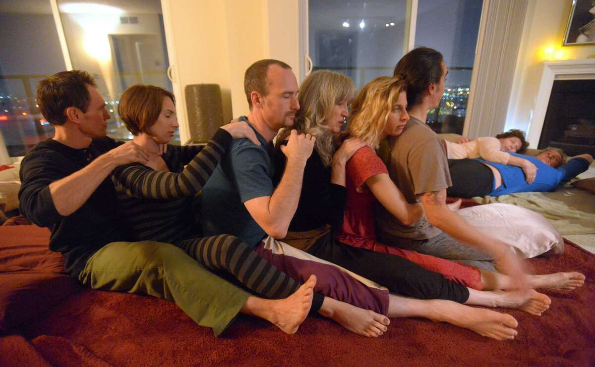 Participants take part in a cuddle party and give each other shoulder rubs at a home in Marina Del Rey, CA on Monday, November 25, 2013.