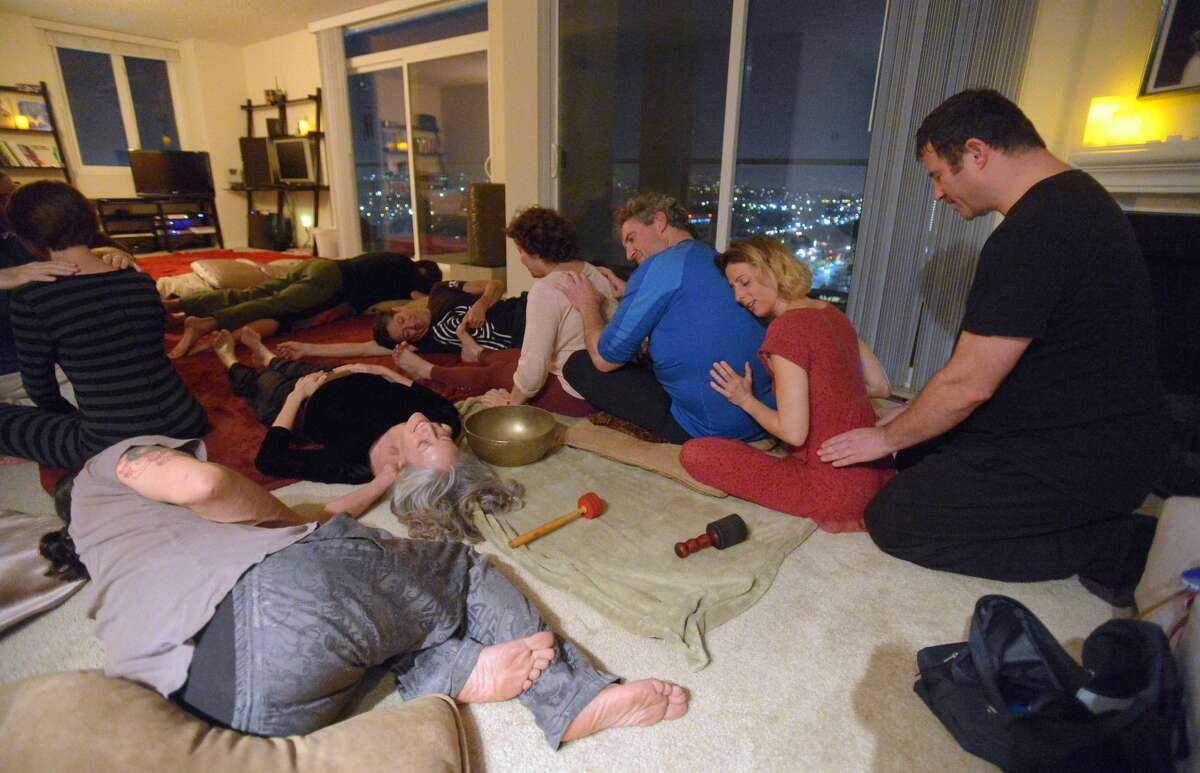 Participants take part in a cuddle party at a home in Marina Del Rey, CA on Monday, November 25, 2013.