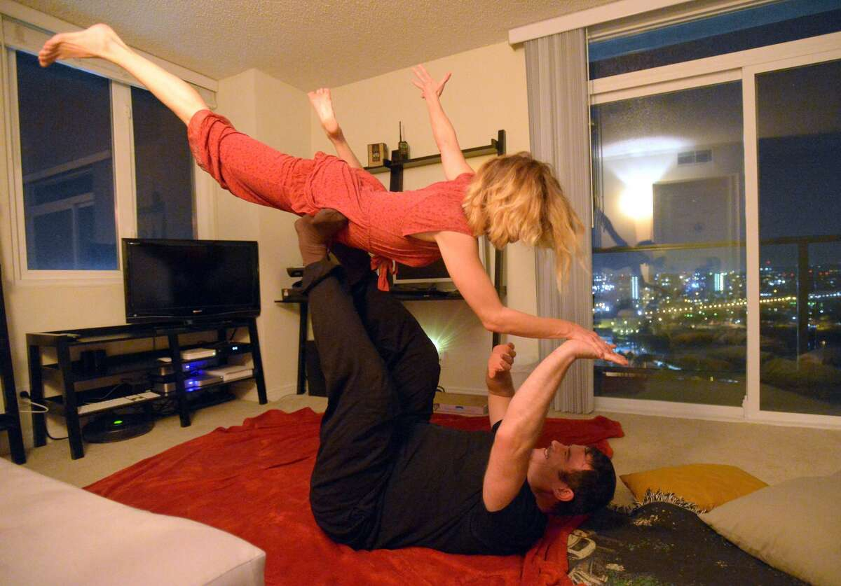 Participants take part in a cuddle party at a home in Marina Del Rey, CA on Monday, November 25, 2013. Group faciltator Jean Franzblau and Martin Libich play around during the event.