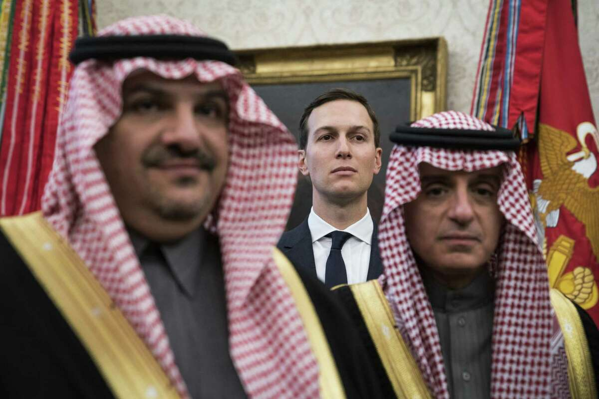 White House senior adviser Jared Kushner stands among Saudi officials as President Trump talks with Crown Prince Mohammad bin Salman of the Kingdom of Saudi Arabia during a meeting in the Oval Office in March.