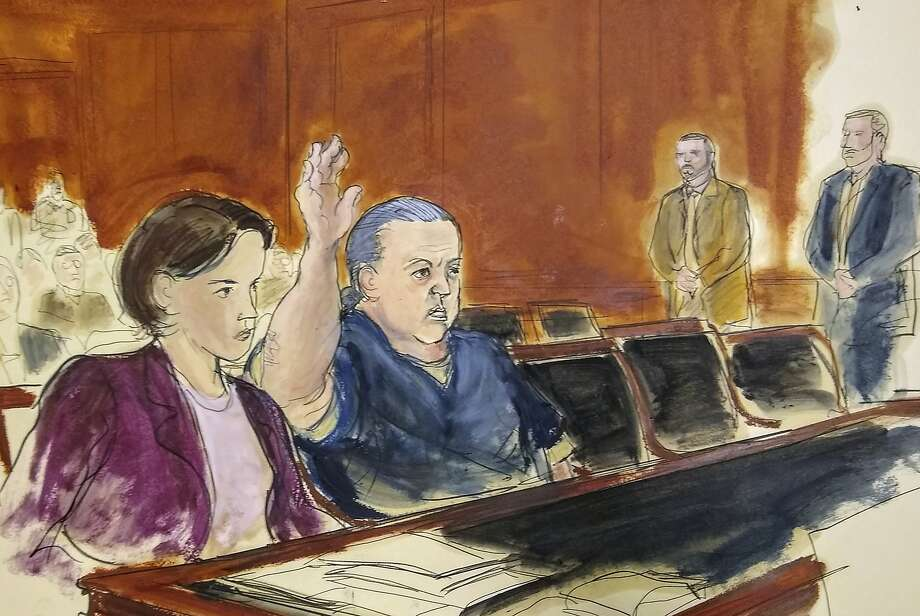 In this courtroom sketch, pipe bombs suspect Cesar Sayoc raises his arm to swear to the truth of his statement of need for assigned counsel in Manhattan Federal Court. At left is Assistant Federal Defender Sarah Baumgartel, while standing far right are U.S. marshals. Photo: Elizabeth Williams / Associated Press