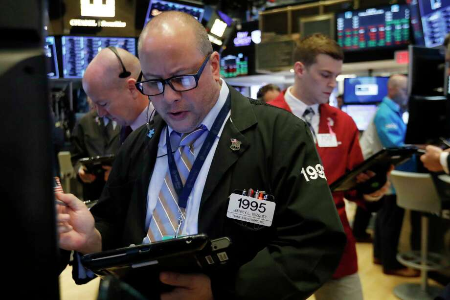 FILE - In this Friday, Oct. 26, 2018, file photo trader Jeffrey Vazquez, center, works on the floor of the New York Stock Exchange. The U.S. stock market opens at 9:30 a.m. EDT on Tuesday, Nov. 6. (AP Photo/Richard Drew, File) Photo: Richard Drew / Copyright 2018 The Associated Press. All rights reserved