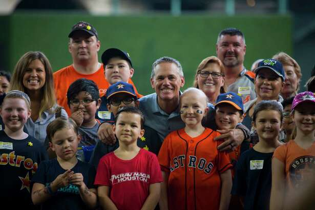 Craig Biggio poses for a group picture during the annual Sunshine Kids Party at Minute Maid Park on Tuesday, Nov. 6, 2018, in Houston. The Biggios have been a big part of Sunshine Kids for the past 20 years. Participants went up to bat against Biggio, ran the bases, explored the field, enjoyed lunch and received lots of Astros goodies.