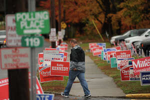 Dozens of campaign signs outside the polls at Orange Avenue School in Milford, Conn. on Tuesday, November 6, 2018.