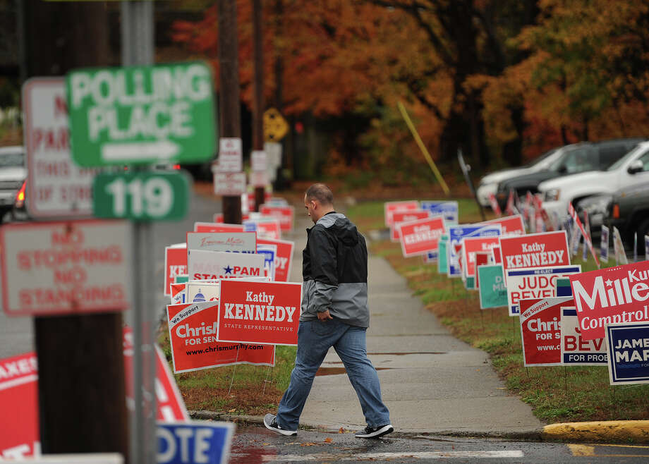 Dozens of campaign signs outside the polls at Orange Avenue School in Milford, Conn. on Tuesday, November 6, 2018. Photo: Brian A. Pounds, Hearst Connecticut Media / Connecticut Post