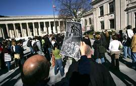 Reg0538 3/27/06 New Haven-- Students and Union members protest Yale's Investments in Private Prisons at Beinecke Plaza at Yale.  Photo-Peter Casolino
