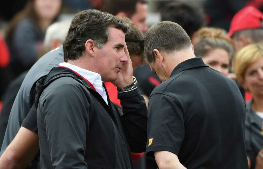 University of Maryland alum and founder of Under Armour Kevin Plank talks with men's basketball coach Mark Turgeon during action against Northwestern at Maryland Stadium. Photo: Washington Post Photo By Jonathan Newton / The Washington Post
