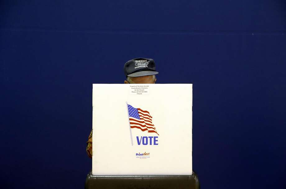 A voter fills out a ballot at a polling place at Lake Shore Elementary School, Tuesday, Nov. 6, 2018, in Pasadena, Md. (AP Photo/Patrick Semansky) Photo: Patrick Semansky / Associated Press
