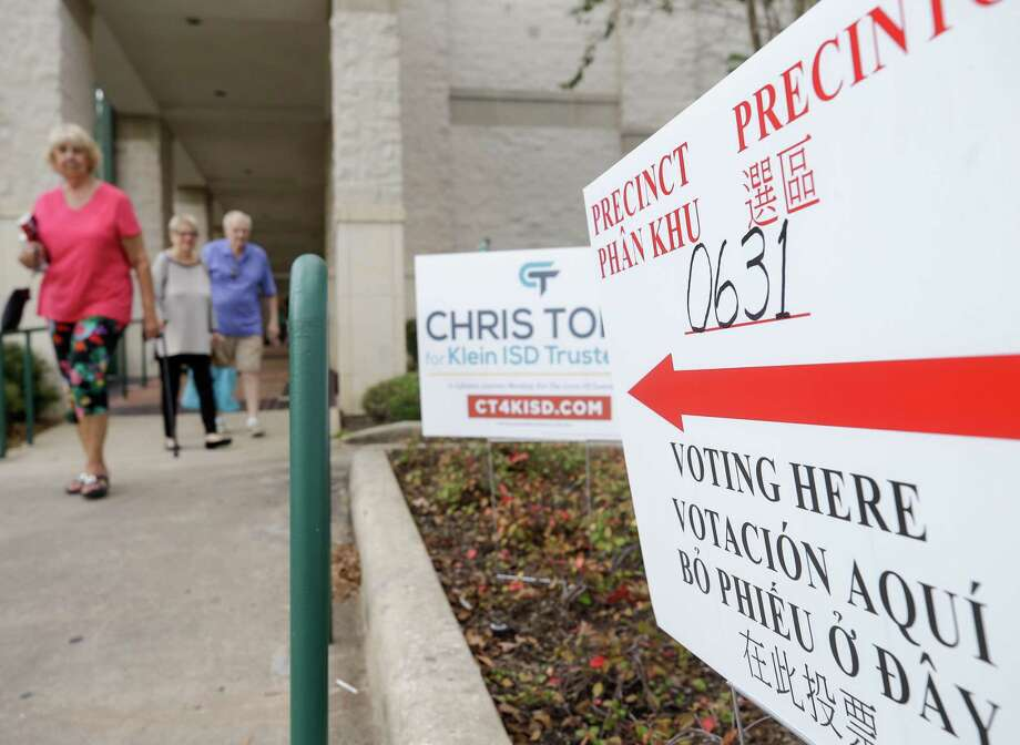 People at a polling location held at the Harris County Public Library Barbara Bush Branch in Spring, Tuesday, November 6, 2018.
