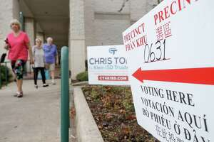 People are shown at the polling location held at the Harris County Public Library Barbara Bush Branch, 6817 Cypresswood Drive in Spring, Tuesday, November 6, 2018.