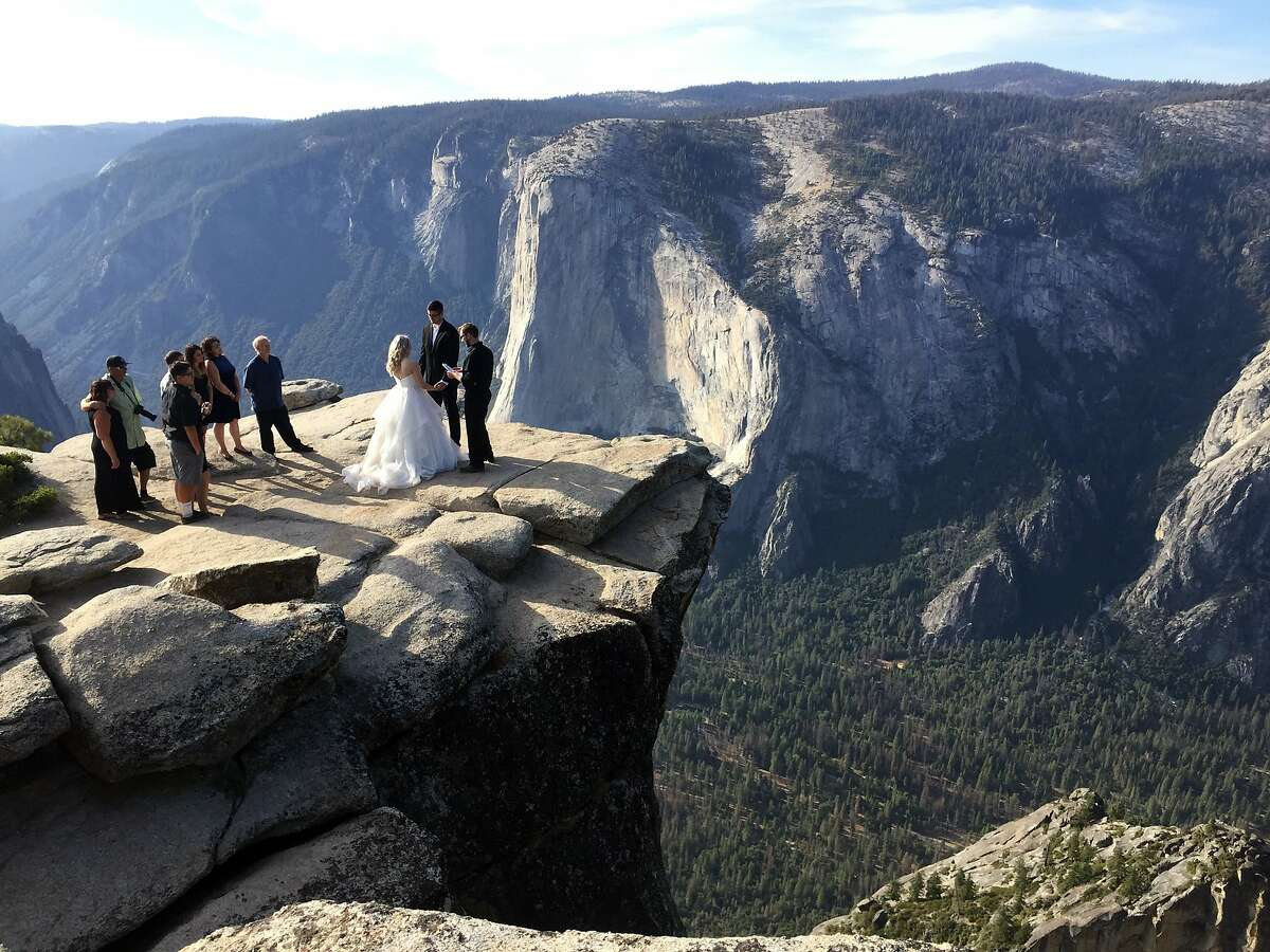 In this Sept. 27, 2018 file photo, a couple is married atop Taft Point in California's Yosemite National Park. Hiking to Taft Point will be far more difficult in 2021, when Glacier Point Road is scheduled to be closed for repair.