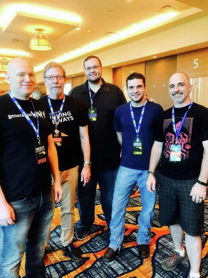 Justin Rimmel and fellow podcasters at CrimeCon. Photo: Diane Lewis