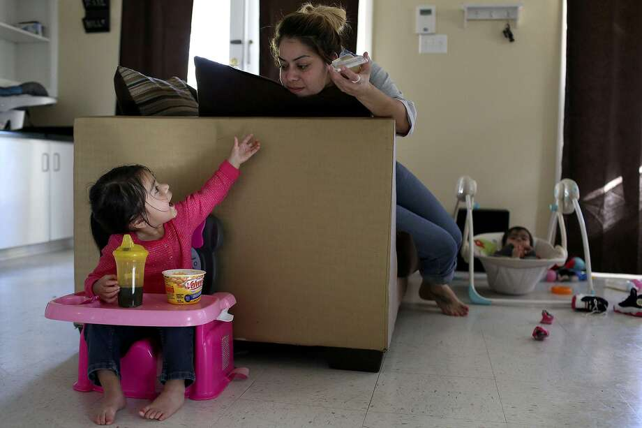 Daughter Lilly Zuniga, 2, is already learning her colors and numbers, said mom Tiffany Garza in 2017, thanks to the quality education she receives at a child care center in the Eastside Promise Neighborhood. But elsewhere in Bexar County, quality child care is lacking. Photo: Lisa Krantz /SAN ANTONIO EXPRESS-NEWS / SAN ANTONIO EXPRESS-NEWS