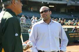 Farhan Zaidi (right), the Oakland Athletics' director of baseball operations, is a Harvard-educated analyst with a doctorate from UC Berkeley in behavioral economics.