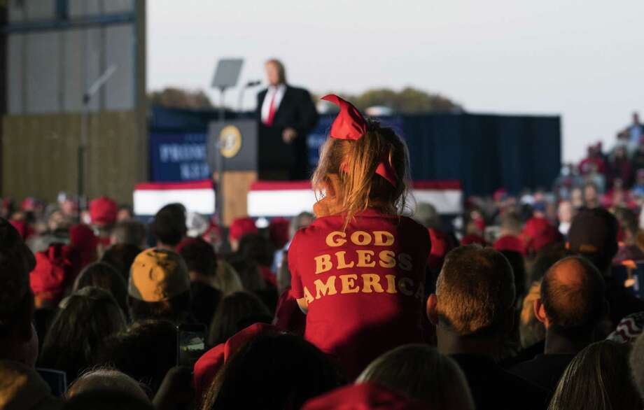 Attendees listen to President Donald Trump on stage during a campaign rally in Murphysboro, Ill., on Oct. 27, 2018. Trump has proposed a different reading of the 14th Amendment, one he said denies birthright citizenship to the children of undocumented immigrants. Trump said he was preparing to issue an executive order to that end. Photo: DOUG MILLS /NYT / NYTNS