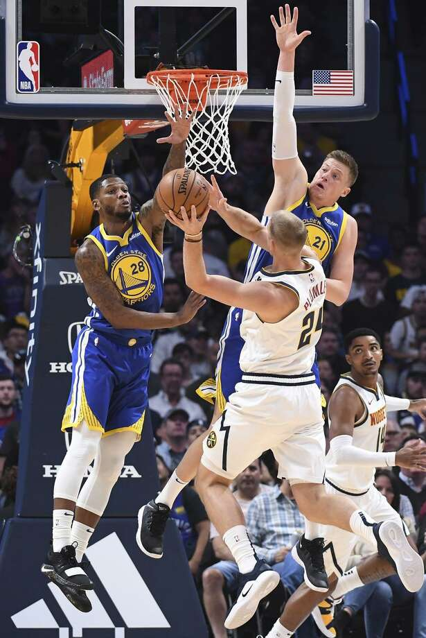 Alfonzo McKinnie (left) and Jonas Jerebko contest a shot by the Nuggets' Mason Plumlee last month in Denver. Photo: Justin Tafoya / Getty Images / 2018 Justin Tafoya
