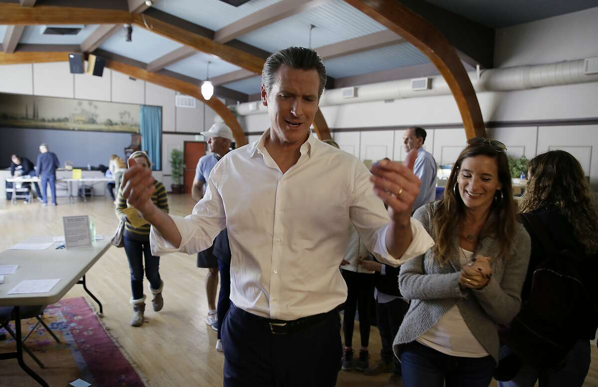 California gubernatorial Democratic candidate Gavin Newsom gestures after voting Tuesday, Nov. 6, 2018, in Larkspur, Calif. (AP Photo/Eric Risberg)