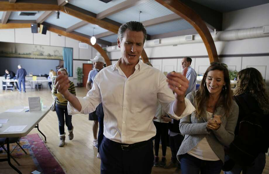 Gavin Newsom leaves his polling station in Larkspur. Photo: Eric Risberg / Associated Press