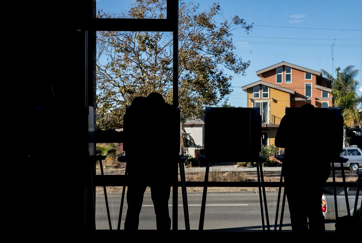 Residents cast their vote in the Midterm Elections at the Destiny Arts Center polling place in Oakland, Calif. Tuesday, Nov. 6, 2018.