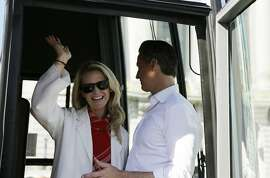 California gubernatorial Democratic candidate Gavin Newsom and his wife Jennifer Siebel Newsom during a bus tour kickoff outside City Hall Tuesday, Oct. 30, 2018, in San Francisco. (AP Photo/Eric Risberg)