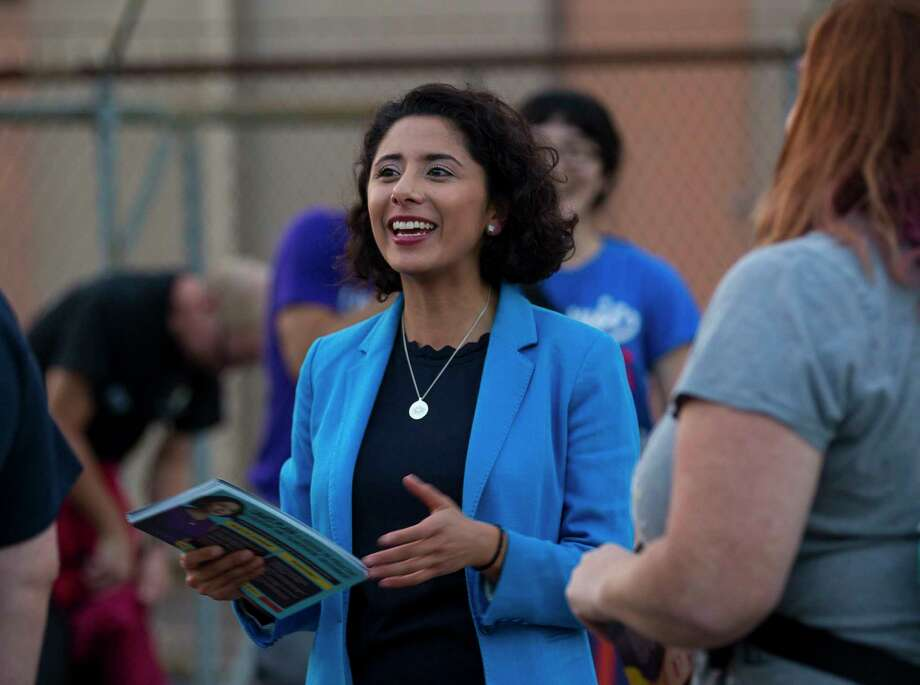 PHOTOS: Things to know about newly elected Harris County Judge Lina Hidalgo Democrat candidate for Harris County Judge, Lina Hidalgo, talks to people going in to vote at a polling place located at the SPJST Lodge 88 in the Heights, Tuesday, Nov. 6, 2018 in Houston.>>> See more little-known facts about Hidalgo  Photo: Mark Mulligan, Staff Photographer / © 2018 Mark Mulligan / Houston Chronicle