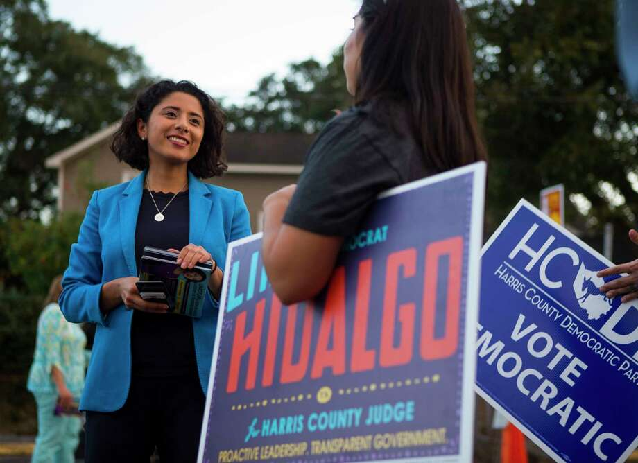 Democrat candidate for Harris County Judge, Lina Hidalgo, talks with campaign volunteers outside of a polling place located at the SPJST Lodge 88 in the Heights, Tuesday, Nov. 6, 2018 in Houston. Hidalgo won a surprise upset of popular incumbent County Judge Ed Emmett. Photo: Mark Mulligan, Staff Photographer / © 2018 Mark Mulligan / Houston Chronicle