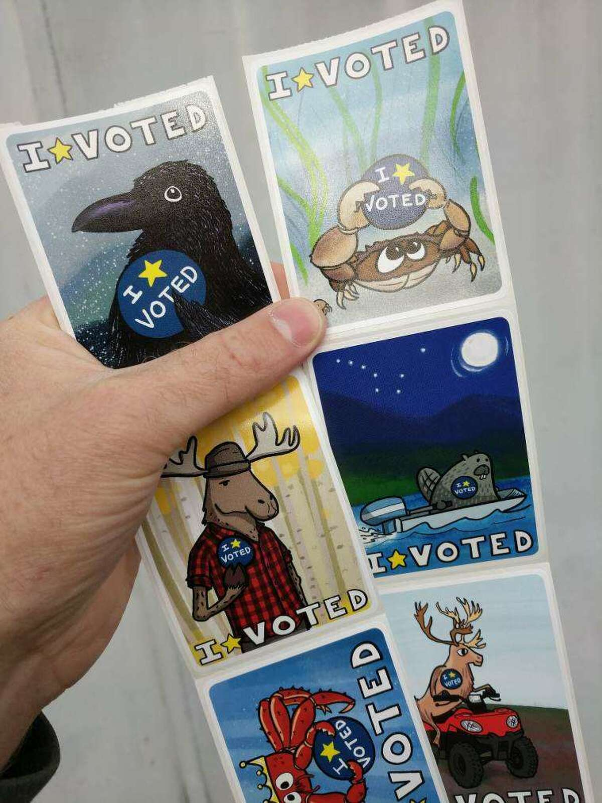 Pat Race, a Juneau-based artist, designed eight stickers given to those who voted early in Alaska.