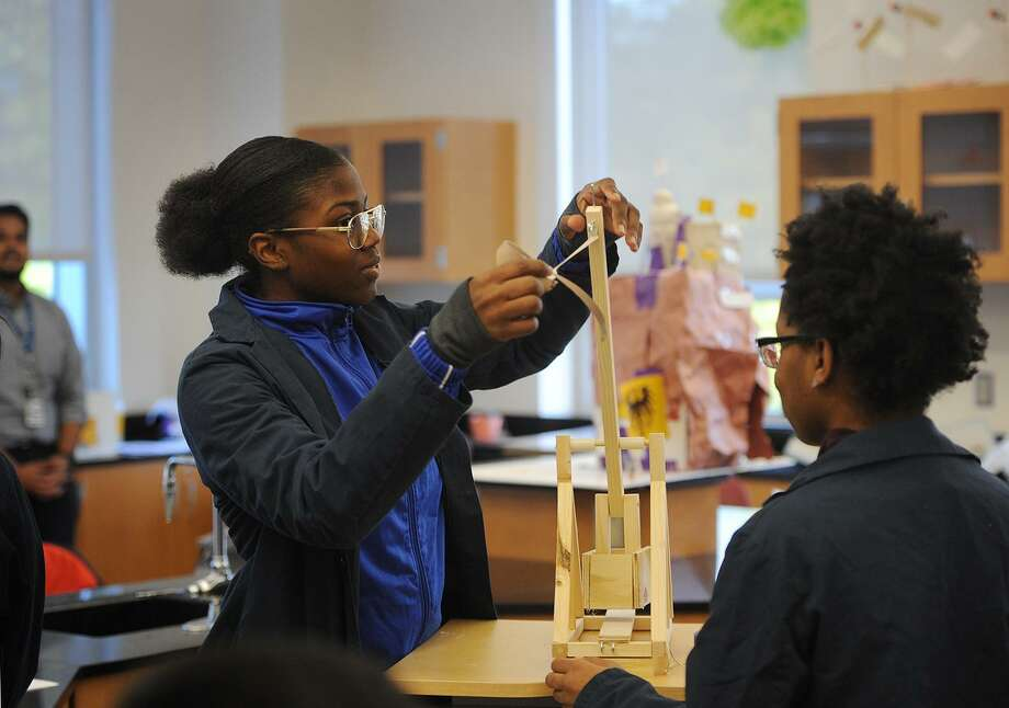 Fairchild Wheeler Magnet High School students Shyni Cross, left, and Zoey Mason, both 16, of Bridgeport, prepare to fire their trebuchet at another team's castle during an exhibition day at the school in Bridgeport, Conn. on Wednesday, October 24, 2018. The school holds periodic exhibition days when classrooms are open for parents to witness project presentations. Photo: Brian A. Pounds / Hearst Connecticut Media / Connecticut Post