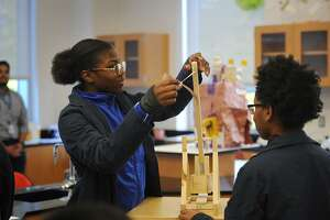 Fairchild Wheeler Magnet High School students Shyni Cross, left, and Zoey Mason, both 16, of Bridgeport, prepare to fire their trebuchet at another team's castle during an exhibition day at the school in Bridgeport, Conn. on Wednesday, October 24, 2018. The school holds periodic exhibition days when classrooms are open for parents to witness project presentations.