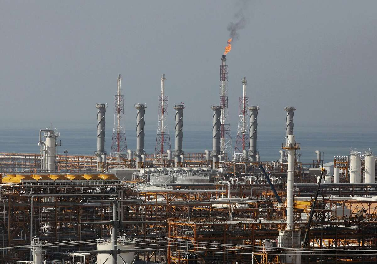 FILE - In this Jan. 22, 2014, file photo, a partially constructed gas refinery at the South Pars gas field is seen on the northern coast of Persian Gulf in Asalouyeh, Iran. NEXT: See which countries are members of OPEC.