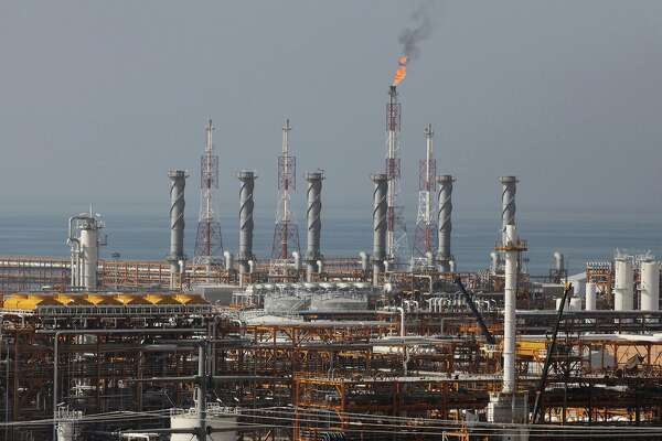 FILE - In this Jan. 22, 2014, file photo, a partially constructed gas refinery at the South Pars gas field is seen on the northern coast of Persian Gulf in Asalouyeh, Iran. Japan, South Korea and other major oil importers welcomed Tuesday the decision by the Trump administration to let them continue to import Iranian crude oil and other petroleum products despite the re-imposition of sanctions on Tehran. (AP Photo/Vahid Salemi, File)