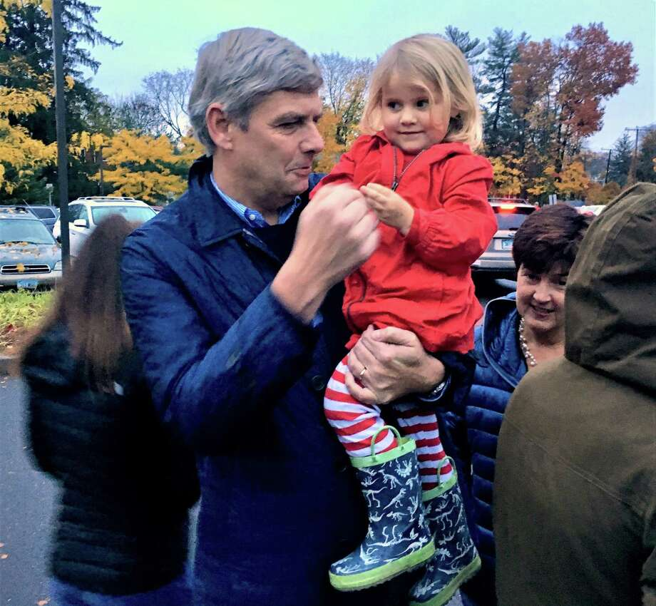 Bob Stefanowski held a niece Tuesday afternoon, at the Bristow Middle School in West Hartford, where he and his wife, Amy, seen at right, and three daughters joined his sister and her family at their neighborhood polling place. Photo: Dan Haar /Hearst Connecticut Media